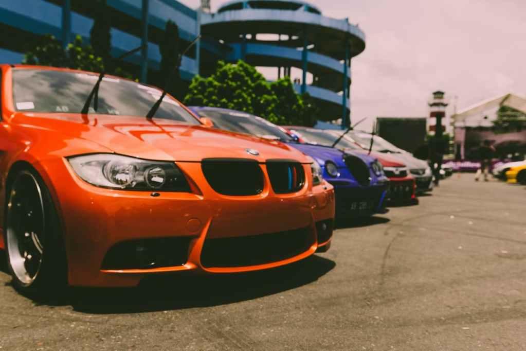 super premium luxury cars parked on road